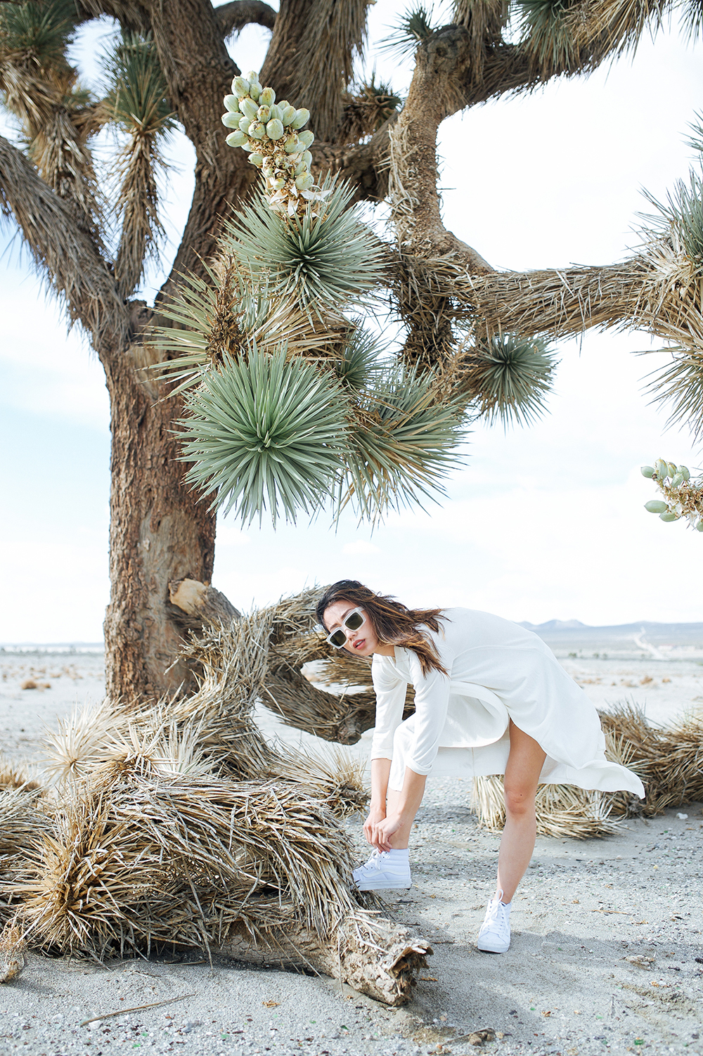 Neon Blush, BlueFly festival style, Whyred wrap dress, Céline white sunglasses, VANS hi top white sneakers, Joshua Tree